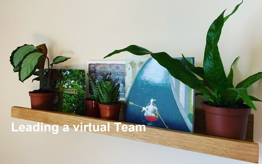 Photo of a small wooden wall shelf with office plants and postcards entitled: Leading a virtual team